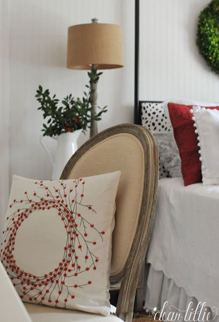 The burlap lampshade from @homegoods helps bring warmth to this white and red guest bedroom that is all ready for Christmas visitors! (sponsored pin)