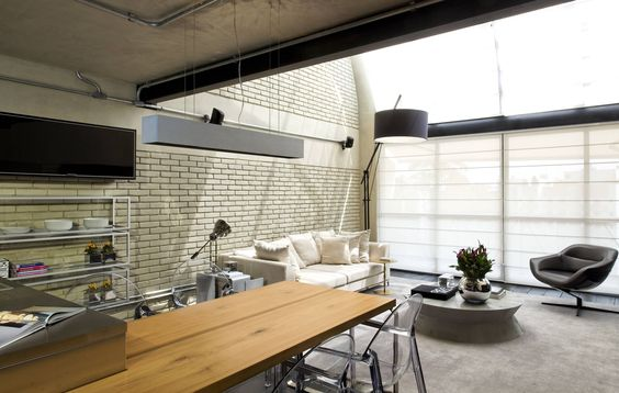 Industrial Loft : Salas de estar industriais por DIEGO REVOLLO ARQUITETURA S/S LTDA.