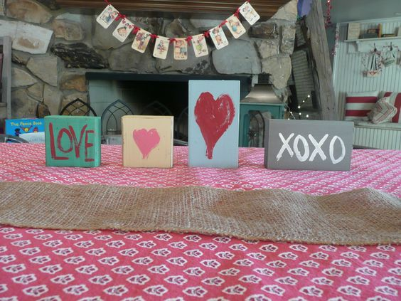 What to do with an old 2 x 4? Cut it into 4-inch squares or 5-inch rectangles, paint them in fun colors, then add a little love--literally.