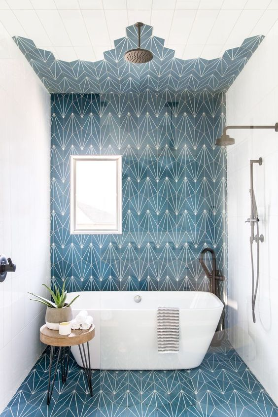 This Kids' Bathroom Is So Chic That Even Adults Will Be Jealous, boho bathroom with bold tile, bole blue geometric tile in bathroom design with modern slipper tub, modern free standing bathtub in bold modern bathroom, fun kid bathroom design with blue tile