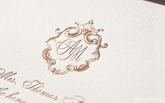 Gold foil monogram on an elegant custom wedding invitation