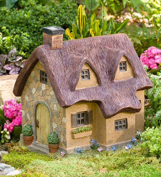 Resin Thatched Fairy Cottage: Turn an ordinary garden into an enchanted garden with our Resin Thatched Fairy Cottage! Offering endless fairy garden ideas for creating a miniature garden display, the highly detailed resin Fairy Cottage features a classic thatched roof with beautiful stonework walls and charming window flower box. Give your enchanted garden fairy-worthy footing with our Moss Milkshake. It grows moss easily anywhere! #fairygarden