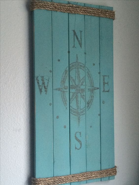 Wood nautical compass sign with rope.