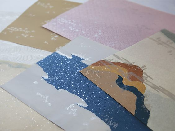 ryōshi papers suitable for poetry anthologies, covered with designs of butterflies, birds and autumn flowers.