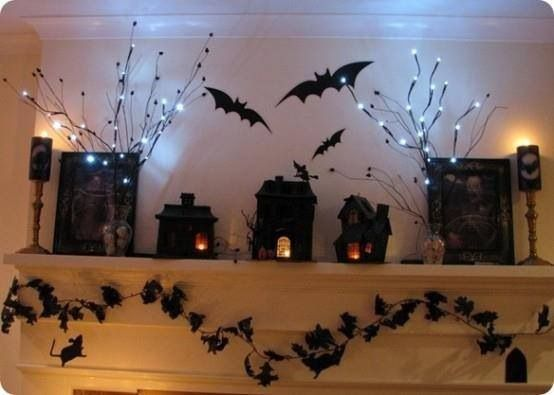 Love the lights and bats on this halloween mantle idea!