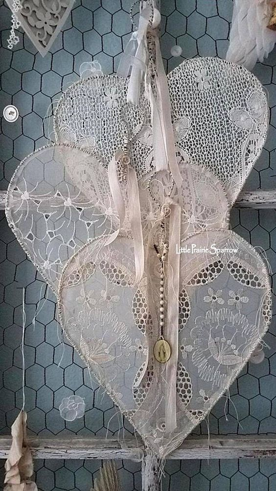 Guinevere I adore vintage and antique lace and anything to do with hearts, so what a perfect match this is. This gorgeous heart is the sixth in my Love Stitched Hearts named Guinevere because this one is fit for a Queen. An abandoned wire hanger was hand tugged and pulled into a