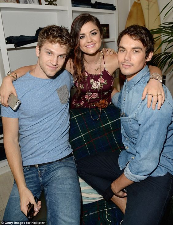 Good pals: The singer poses with her Pretty Little Liars co-stars Keegan Allen (left) and Tyler Blackburn (right)