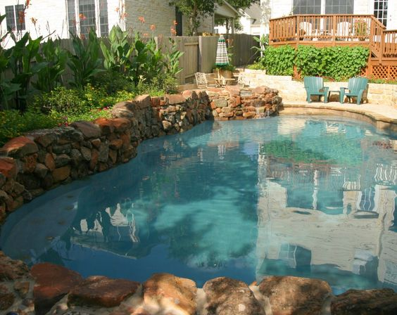 vanishing edge freeform and geometric swimming pool designs by cody pools a pool builder