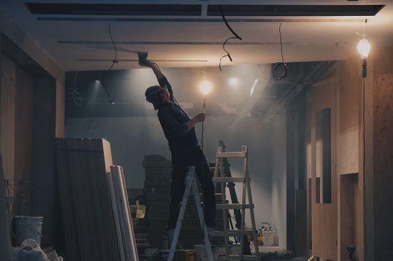Man decorating on ladder