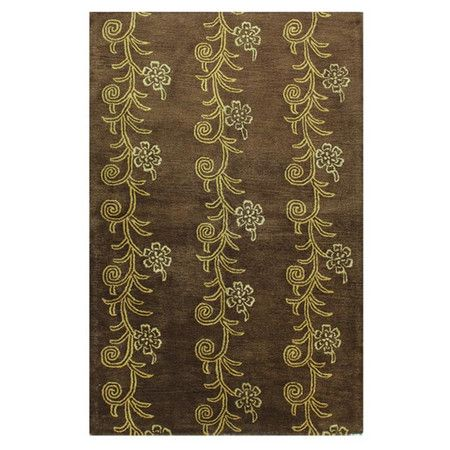 Wool and art silk rug with a floral motif. Hand-tufted in India.      Product: RugConstruction Material: Wool and ar...