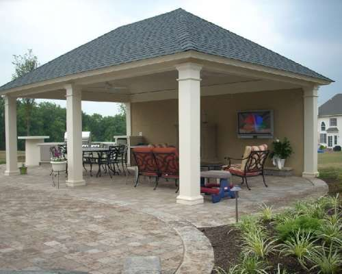Freestanding cabana with hipped roof outdoor fireplace for Outdoor cabana designs