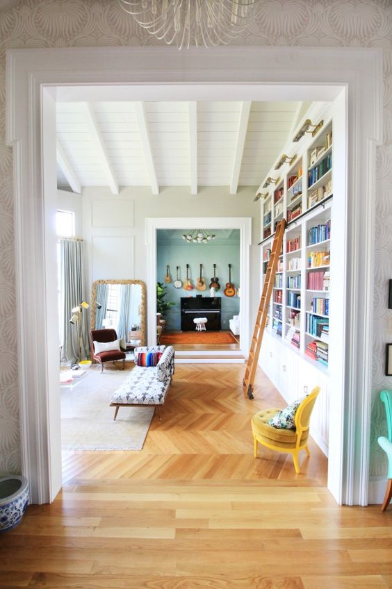 The green blue behind the library shelves with the for Music living room ideas