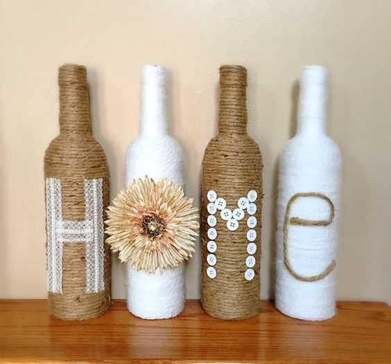Wine Bottle Decor A set of 4 wine bottles - 2 wrapped in twine and 2 wrapped in white yarn - that spell HOME. Custom colors or words are: