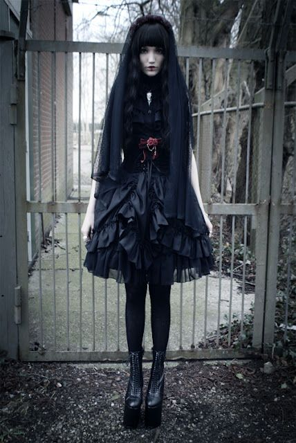 Gothic Lolita....Just ignore the creepy girl's face lol. I only like the dress and shoes she's wearing.