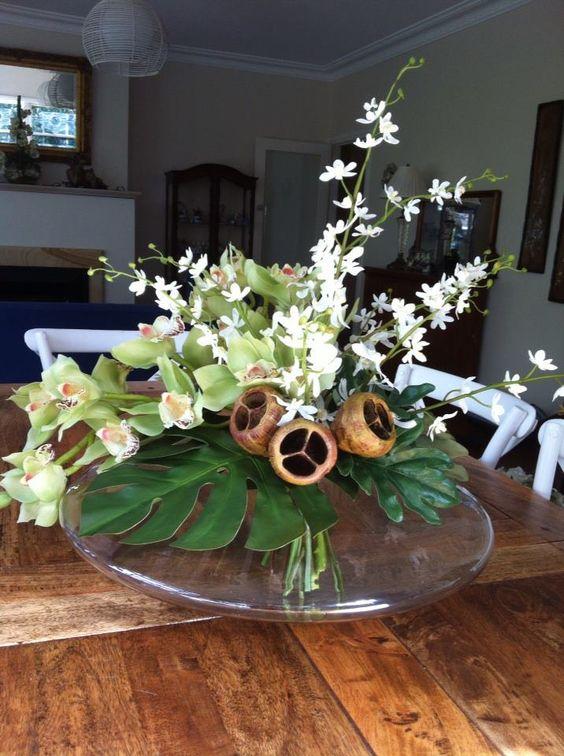 stunning cymbidium orchids in a UFO shaped vase.
