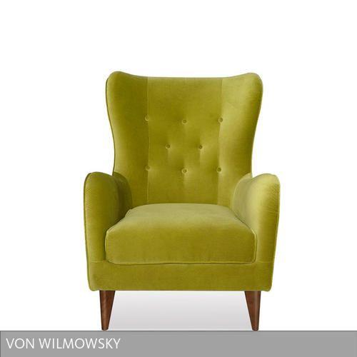 """Klassisch elegant präsentiert sich der Ohrensessel """"Norby"""" von Von Wilmowksy. Sanft geschwungene Linien und eine großzügige Polsterung machen den Sessel mit…"""
