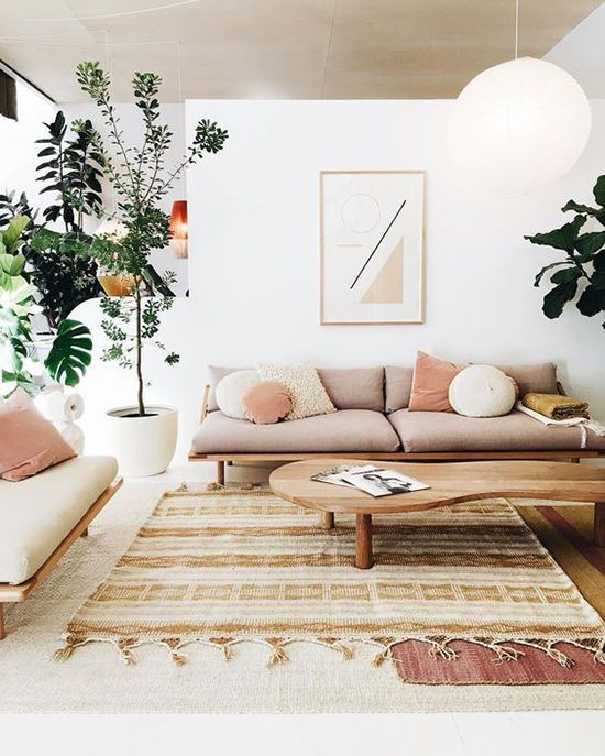 Blush pink living room with plants