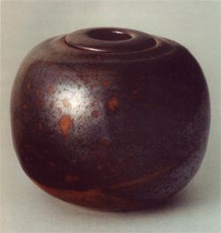 "I. While Eva prepares dinner, I am in the living room holding a ceramic pot in my hands. ""Eva, tell me about the large brown pot by the window. It looks like it wasn't made. It looks more like it w..."