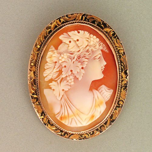 Antique Hand Carved Shell Cameo Pendant/Brooch Of A Woman With Grapes And Grape Leaves In Her Hair, Mounted In A 12k Pink Gold Twisted Wire And Engraved Frame