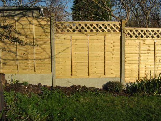 Standard lattice-top fence panels, stepped