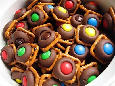 Pretzel, Hershey Kiss, and M&M Bites.  Can also be made with Rolos instead of kisses!