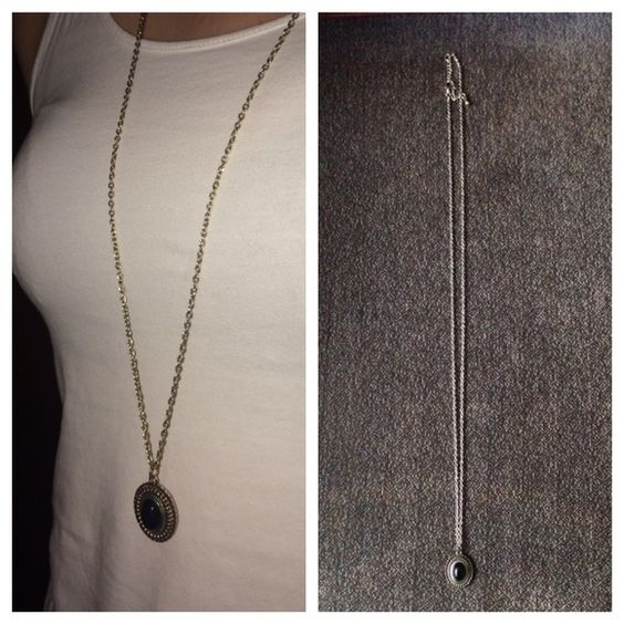 Black Stone Necklace Adorable necklace with a black stone. Very light in wear. It's never been worn!  Jewelry Necklaces