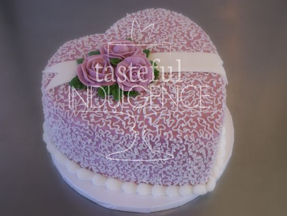 Romantic Valentine heart shaped cake, accented with cornelli lace piping, banner and roses.    #caketodiefor  Seward, Nebraska