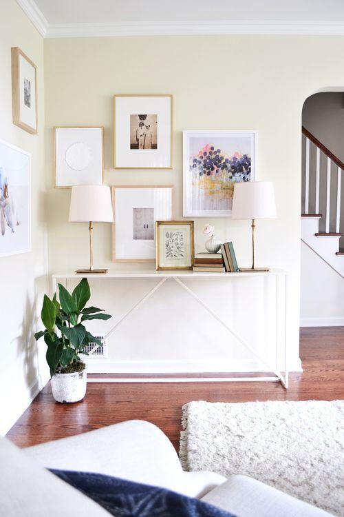 white consol table + bright gallery wall   rehabitat