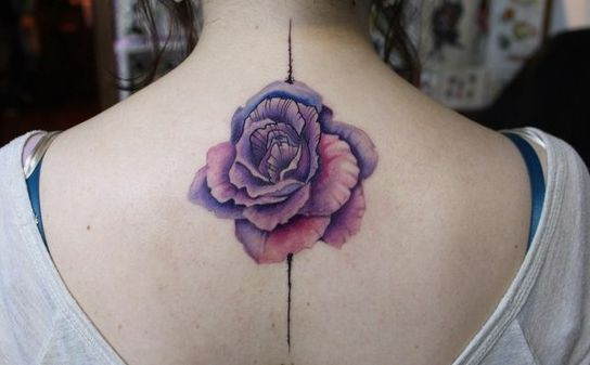 Beautifully detailed flower tattoo.