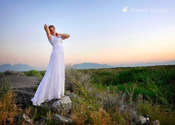 bridal with mountains and reeds at the lake shore after sunset