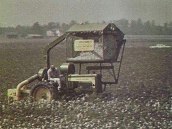 John Deere 430 with mounted cotton picker.