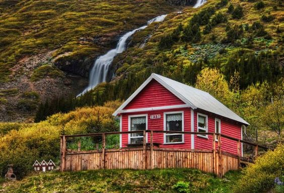 Tiny house in the landscape with even tinier houses, built for the elves nearby (just to the left).  Taken in Iceland by Trey Ratcliff.