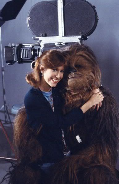 Carrie Fisher snuggling with Chewie