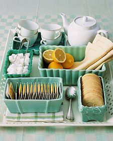 Everything for tea, organized in vintage planters!