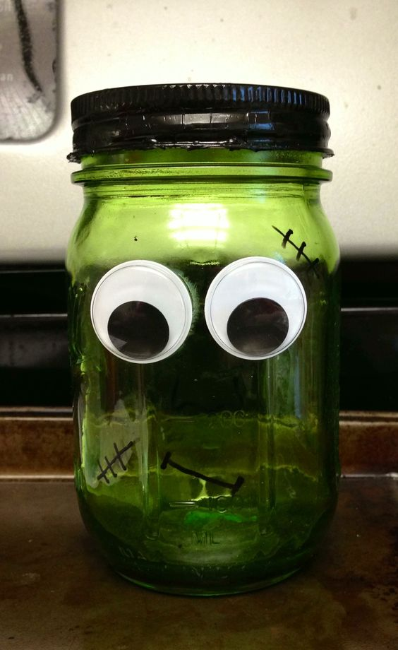 Frankenstein Mason Jar Halloween DIY idea. Use the tinting mason jars tutorial we have posted, some black paint for the lid and stitches, and glue on some big googly eyes!