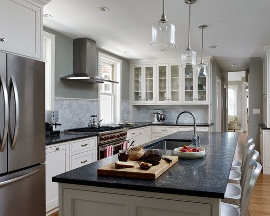 Here we have white with even more white and the black granite seems to break that up. You still don't get too much dark, but you also get just the right amount of balance so you're not looking at a boring kitchen in all one color.