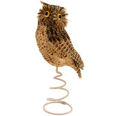 """A <em>wise old bird</em> told us this distinctive topper makes the perfect touch on your tree! Compressed Styrofoam transforms into the stunning, nocturnal creature through a covering of soft, life-like feathers. Attached to a felt-covered metal coil with a 3¾"""" base diameter for easy display, this unique feathered brown owl tree topper measures approximately 15¼"""" tall and peers through prominent, golden eyes that seemingly """"glow"""". Completing the tree's décor with this magnificent woodland…"""