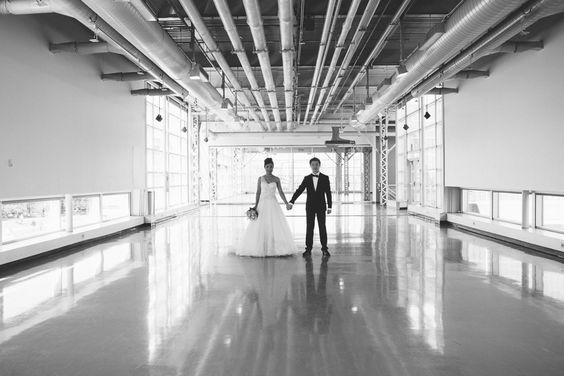 Pauline + Richard standing in the middle of an industrial hallway :: #wedding :: www.richardpham.ca
