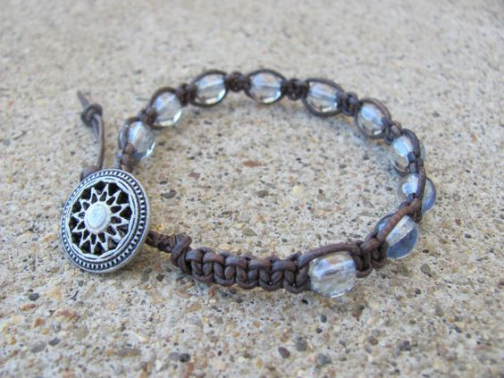 Leather knotted blue luster transparent glass bead bracelet
