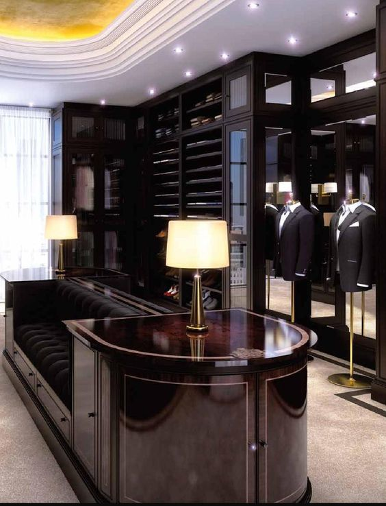 stylish walk-in closet for men with dark color closets and sofa #dark #closet #storage #organization #allenrothCloset #allenAndRothCloset #closetShelves