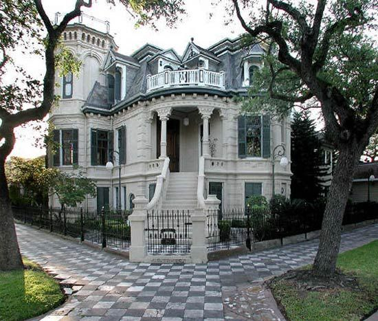 Galveston TX Gothic-Victorian house. The 21-room mansion features 32  stained-glass windows, four fireplaces and a widow's walk; inside, it's  full o