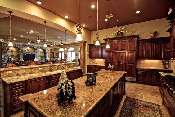 We've got plenty of deep and dark colors going on here but it all creates an elegant form of cohesiveness. You get dark cherry cabinets, the dark Giallo Veneziano granite on the countertops, the floors and part of the backsplash and more, all work together.