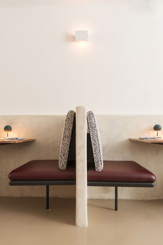 Nix Restaurant in New York The seat backs on the smaller banquettes are covered in a custom fabric based on a painting by author and artist Leanne Shapton, who is also Truman's wife. The mushroom-shaped green light fixtures are custom designs by Robert