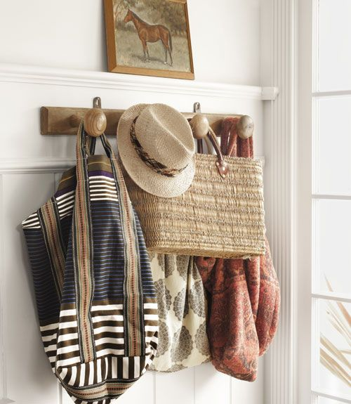 with my growing-up girls, we've just instituted a row of hooks dedicated to bags and purses... love this inspiration