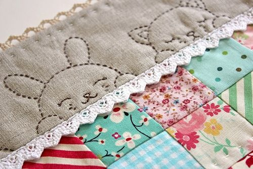 Such a cute idea for the border of baby quilt....makes me think you could create your own simple design to border a small blanket or even placemats....so pretty. It turns a homemade sewing project into an heirloom.