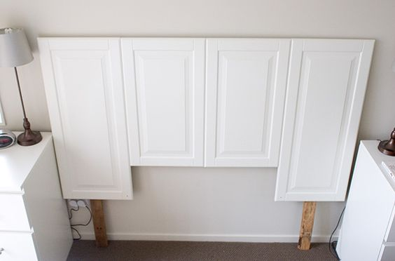 Salvaged cabinet doors repurposed into headboard; who knew ...