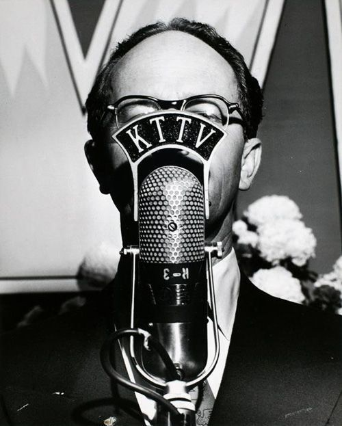 Weegee :: KTTV announcer behind his microphone, Los Angeles, California, 1951
