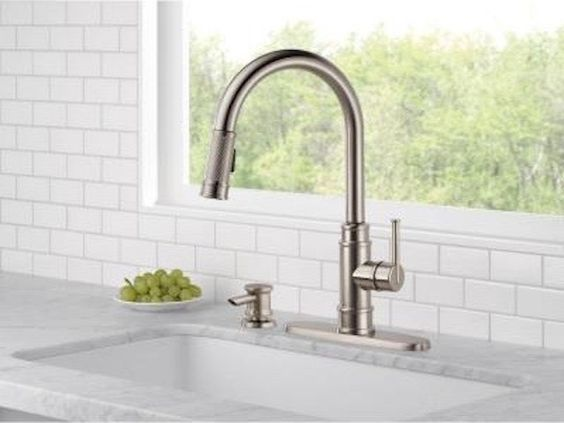 consider swapping out an old faucet with a fitting new one that enhances your kitchen sink. This Allentown pull-down kitchen faucet is awesome for an updated farmhouse sink!