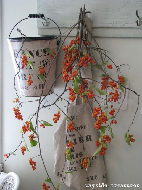Love clippings worked into seasonal decor. This is bittersweet (pinned from Wayside Treasures)