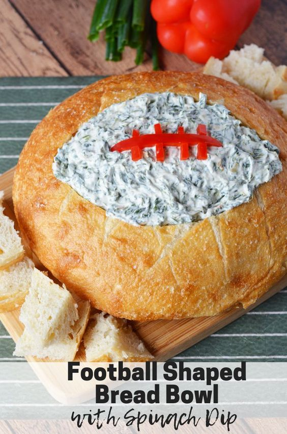 This Football Shaped Bread Bowl With Spinach Dip would make the perfect appetizer for your Super Bowl party. #footballparty #footballfood #superbowl #recipes #spinachdip #spinach #appetizerseasy #appetizers